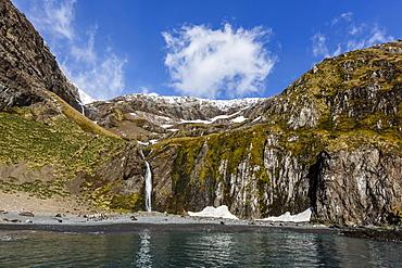 Snowmelt waterfall in Hercules Bay, South Georgia, Polar Regions