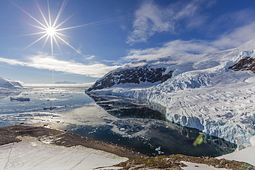 Ice choked waters surrounded by ice-capped mountains and glaciers in Neko Harbor, Antarctica, Polar Regions