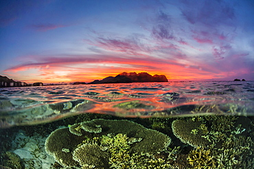 Half above and half below view of the Komodo Diving Resort at sunset, Sebayur Island, Flores Sea, Indonesia, Southeast Asia, Asia