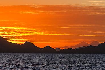 Sunset over Komodo National Park, Rinca Island, Flores Sea, Indonesia, Southeast Asia, Asia