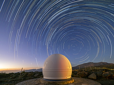 Star trails over an observatory on Jebel Shams, the highest mountain of the Hajar range, Sultanate of Oman, Middle East