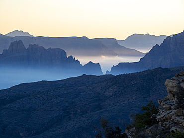 Low-lying clouds fill the valley at sunrise at Sharaf Al Alamayn, Sultanate of Oman, Middle East