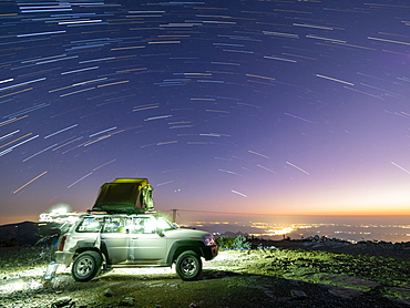 Star trails over truck camping site at Sharaf Al Alamayn, Sultanate of Oman, Middle East