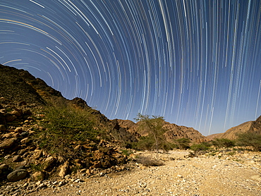 Star trails at night in Wadi Al Arbeen, Sultanate of Oman, Middle East