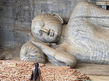 The reclining Buddha figure inside Gal Viharaya, UNESCO World Heritage Site, Polonnaruwa, Sri Lanka, Asia