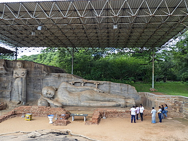 The reclining Buddha figure inside the Gal Viharaya, Polonnaruwa, UNESCO World Heritage Site, Sri Lanka, Asia