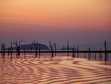 Sunset over Lake Kariba, the world's largest man-made lake and reservoir by volume, Zimbabwe, Africa
