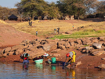 Women doing laundry in the fishing village of Musamba, on the shoreline of Lake Kariba, Zimbabwe, Africa