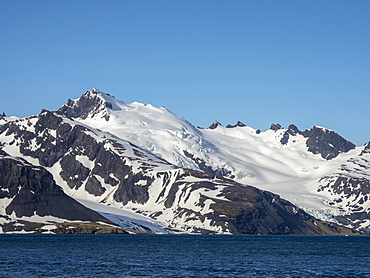 Snow-covered mountains in King Haakon Bay, South Georgia, Polar Regions
