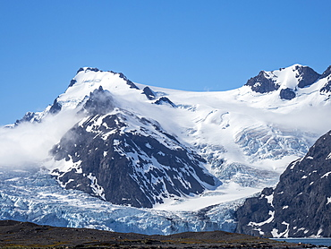 Snow-covered mountains and glaciers in King Haakon Bay, South Georgia, Polar Regions