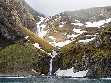 Glacier and meltwater waterfall in Hercules Bay, South Georgia, Polar Regions