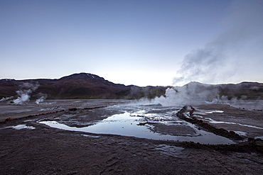 Pre-dawn light on the Geysers del Tatio (El Tatio), the third largest geyser field in the world, Andean Central Volcanic Zone, Antofagasta Region, Chile, South America