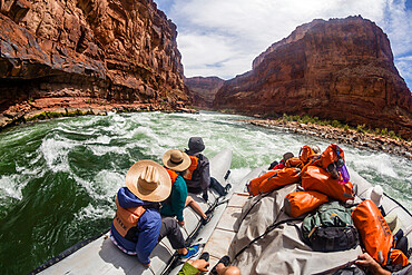 Shooting the rapids in a raft on the Colorado River, Grand Canyon National Park, Arizona, USA, North America.