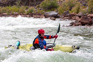 Shooting rapids in a kayak on the Colorado River, Grand Canyon National Park, Arizona, USA, North America.