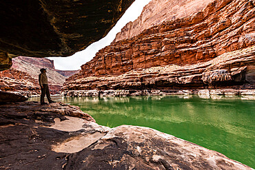 A hiker in Marble Canyon along the Colorado River, Grand Canyon National Park, Arizona, USA.