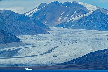 Tidewater glaciers and ice-capped mountains in Eclipse Sound, Nunavut, Canada, North America