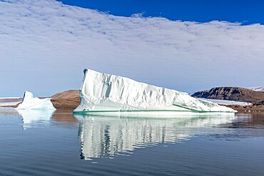 Grounded icebergs calved from nearby glacier in Makinson Inlet, Ellesmere Island, Nunavut, Canada, North America