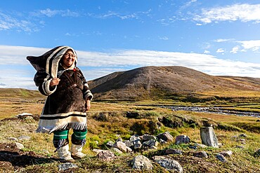 Inuit woman in traditional handmade clothing, Pond Inlet, Mittimatalik, in northern Baffin Island, Nunavut, Canada.