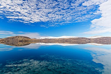Reflections in the calm waters of Makinson Inlet, Ellesmere Island, Nunavut, Canada, North America