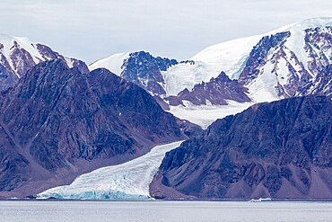 Tidewater glacier in the calm waters of Makinson Inlet, Ellesmere Island, Nunavut, Canada, North America
