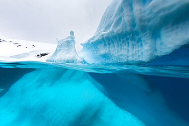 Above and below view of an iceberg at Cuverville Island, Ererra Channel, Antarctica, Polar Regions