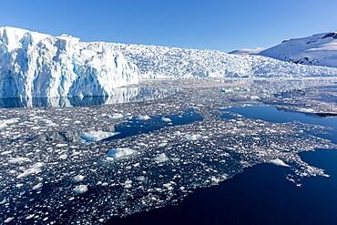 Snow-covered mountains, glaciers, and brash ice in Cierva Cove, Hughes Bay, Antarctica, Polar Regions
