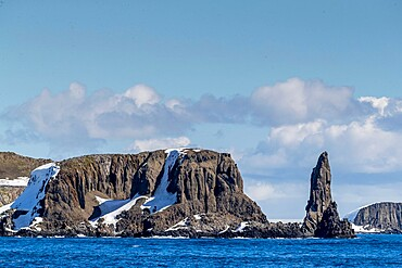 Basalt pinnacle and cliffs in English Strait in the South Shetland Islands, Antarctica, Polar Regions