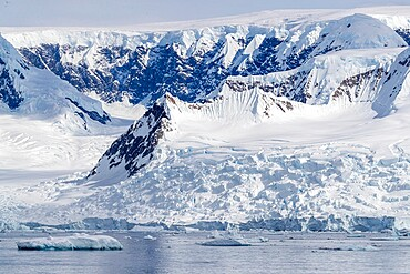 Snow-covered mountains, glaciers, and icebergs in Lindblad Cove, Charcot Bay, Trinity Peninsula, Antarctica, Polar Regions