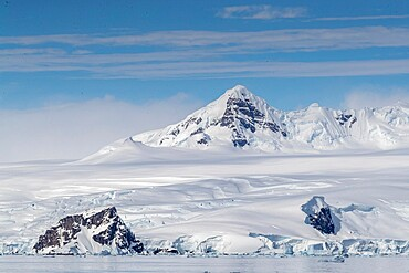 Snow-covered mountains and tidewater glaciers in Mikkelsen Harbor, Trinity Island, Antarctica, Polar Regions