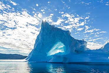 Sunburst on iceberg in Holms O, Baffin Bay, on the northwest coast of Greenland, Polar Regions