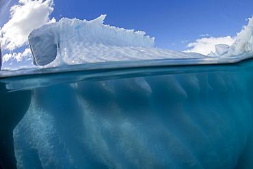 Half above and half below photo of an iceberg off Danco Island, Antarctica.