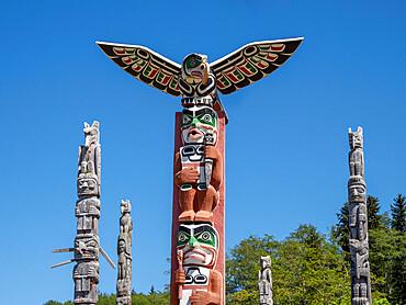 Kwakwaka'wakw totem poles in the cemetery in Alert Bay, Cormorant Island, British Columba, Canada.