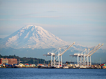 View of the commercial docks in Seattle with Mt. Rainier in the back, Washington State, United States of America.