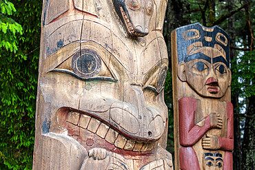 totem poles in Freedom Park, just outside the city of Sitka, Southeast Alaska, USA.