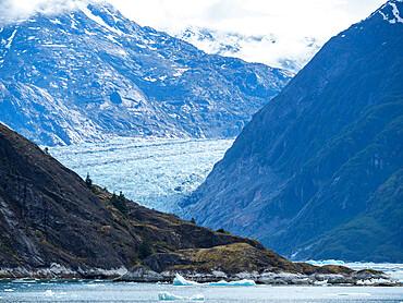 Retreating tidewater South Sawyer Glacier meets the rock, Tracy Arm, Southeast Alaska, USA.