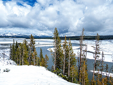 The Yellowstone River surrounded by snow-capped mountains, Yellowstone National Park, Wyoming, USA.