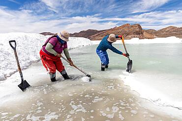 Salt workers near Coqueza, a small town near the Thunupa Volcano, Salar de Uyuni, Daniel Campos Province, Bolivia.