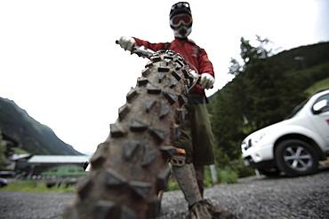Man holding his mountainbike, Ischgl, Tyrol, Austria