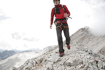 Man hiking along Jubilaeumsgrat, Garmisch-Patenkirchen, Bavaria, Germany