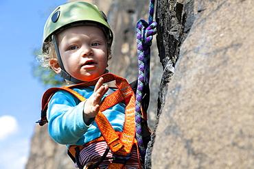 Boy (2 years) climbing in a quarry near Leipzig, Saxony, Germany