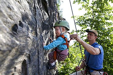 Boy (2 years) climbing in a quarry, Leipzig, Saxony, Germany