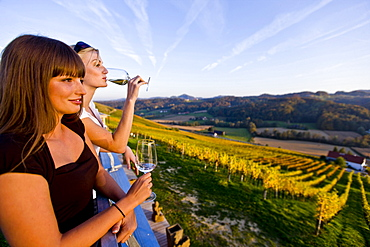 Two young women drinking white wine, Gamlitz, Styria, Austria