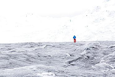 Man walking over a glacier, Artesonraju, Paron Valley, Caraz, Huaraz, Ancash, Cordillera Blanca, Peru