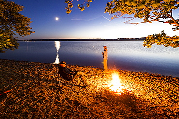 Two men at a campfire, Lake Starnberg, Berg, Upper Bavaria, Germany