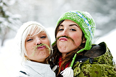 Two young women with fake beards