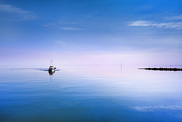 Boat in calm water, Hallig Langeness, North Frisian Islands, Schleswig-Holstein, Germany