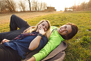 Young couple on a blanket, Grosser Alpsee, Immenstadt, Bavaria, Germany