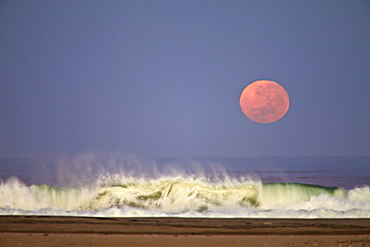 Moon setting along the skeleton coast, Namibia