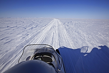 Snowmobile driving on the frozen ocean, Chukotka Autonomous Okrug, Siberia, Russia