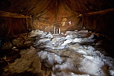 Polok, a sleeping area in a Yaranga, the tent of the reindeer nomads, laid out with reindeer skins, Chukotka Autonomous Okrug, Siberia, Russia